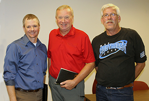 Gene Pelowski (Red Shirt, Center)