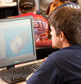 Student looking at a 3D rendering on a computer screen